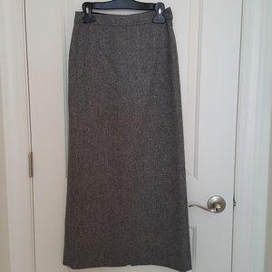 Ann Taylor size 2 long skirt w slit on the back.
